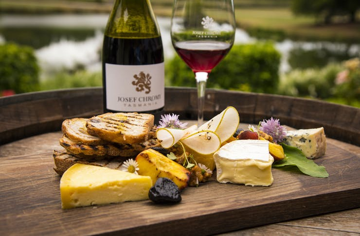 a cheese platter and wine