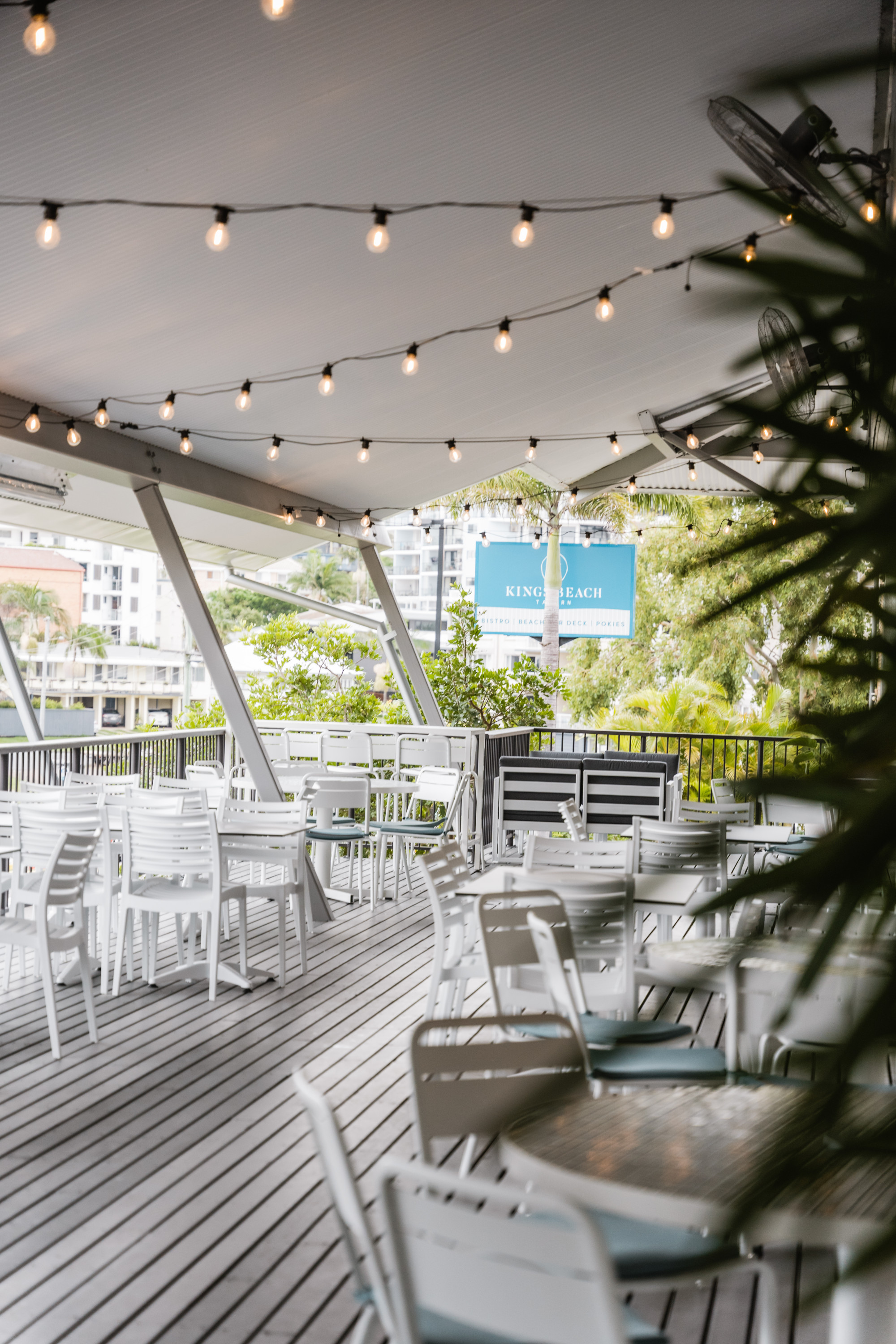 kings beach tavern's white outdoor deck with fairy lights