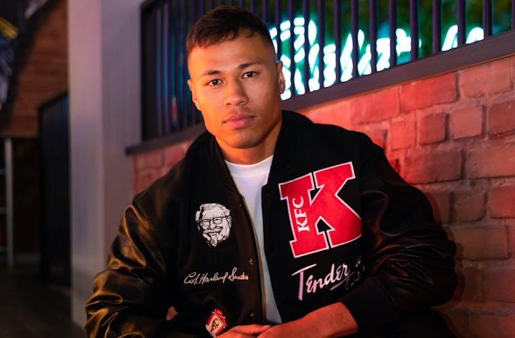 A person wearing the KFC Varsity Jacket