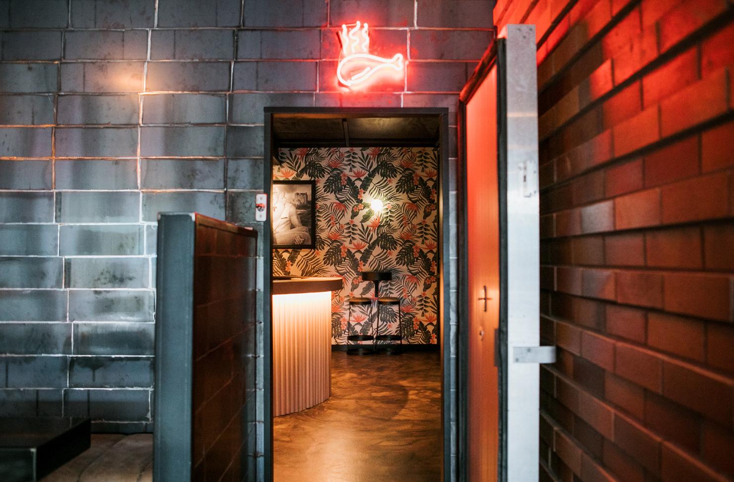 A refrigerator door leads to a hidden bar in a Noosa restaurant.