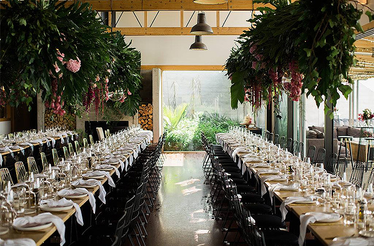 A long table decorated with beautiful flowers at Kauri Bay Boomrock.
