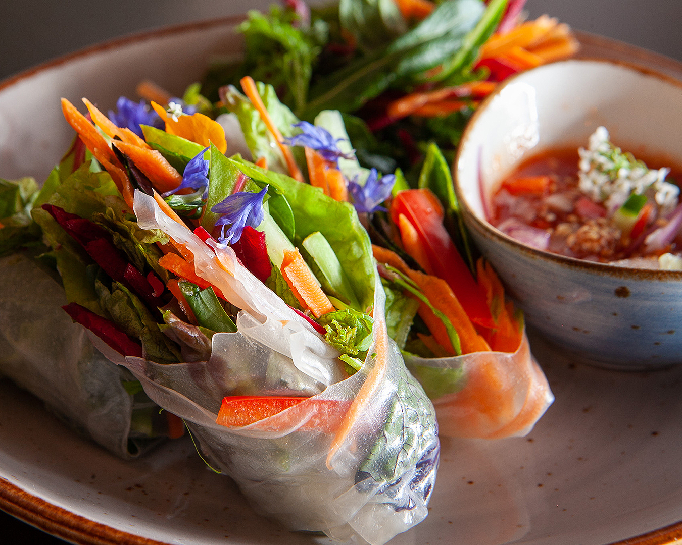 Khu Khu spring rolls looking fresh and delicious on a plate.