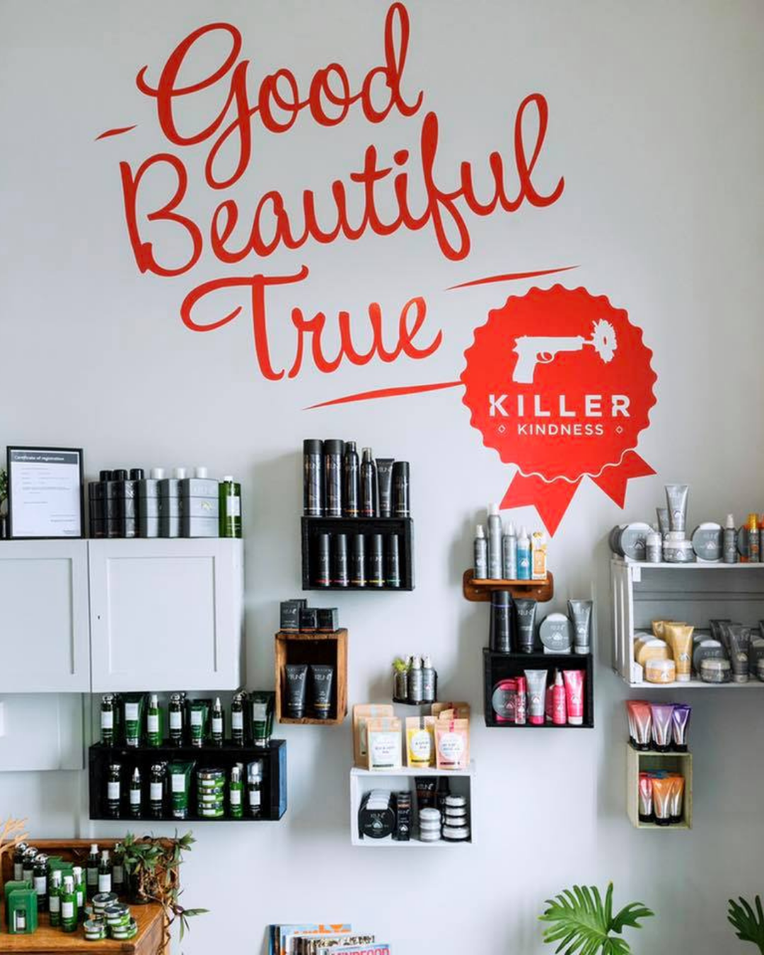 A wall with shelves displaying hair products inside the salon.