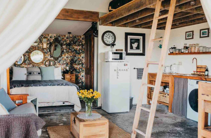 a cluttered tiny home with lots of knick knacks and art on the walls.