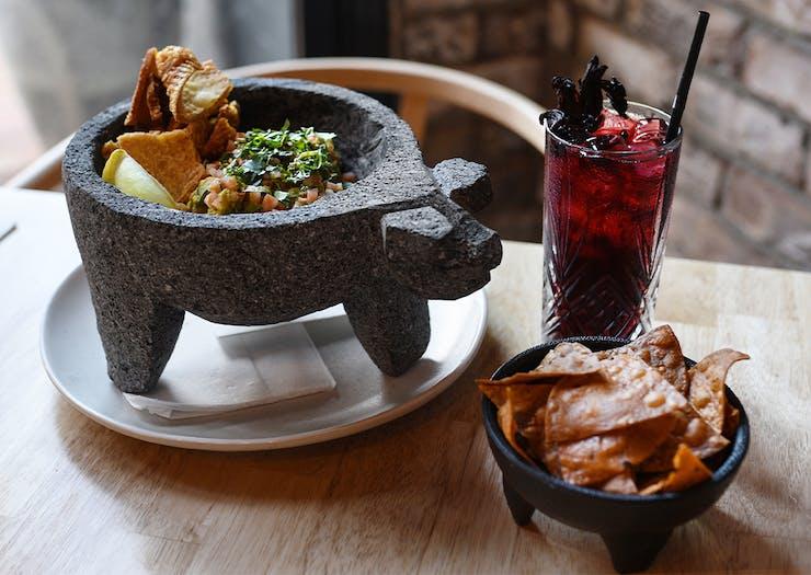 A pig shaped bowl of guacamole
