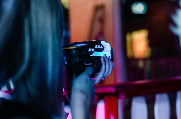 Person holding a laser tag gun and pointing at something