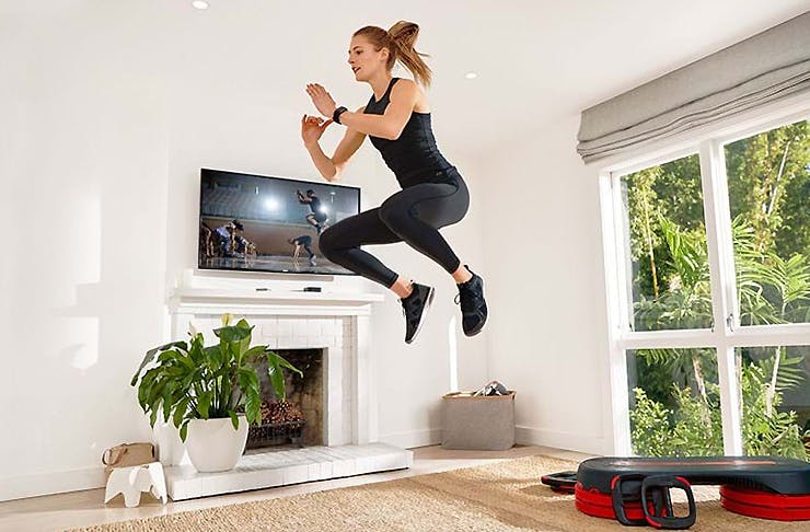 Woman getting active in the front room