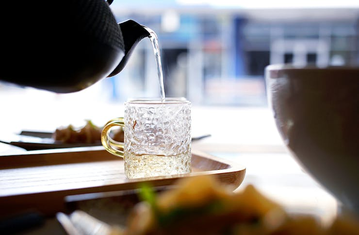 Chinese tea being poured into glass mug