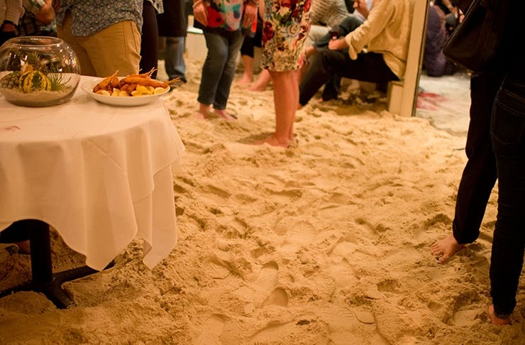 A restaurant filled with sand
