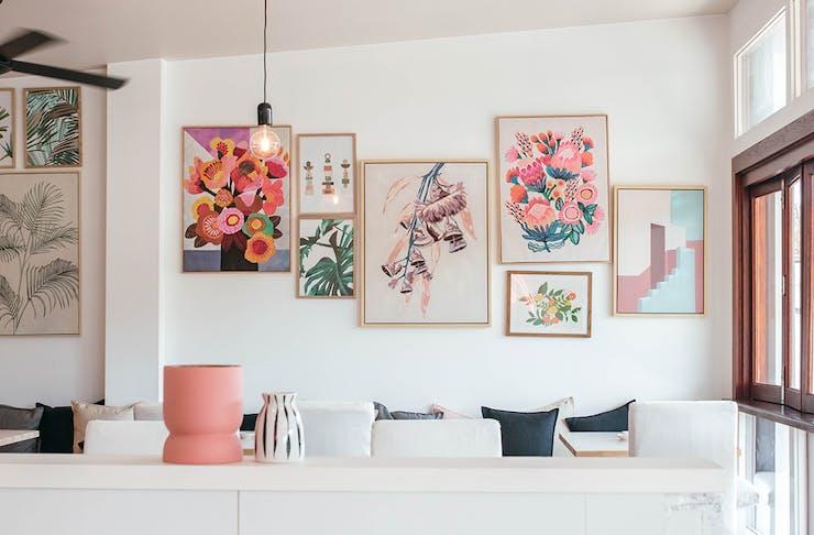 a wall full of art prints