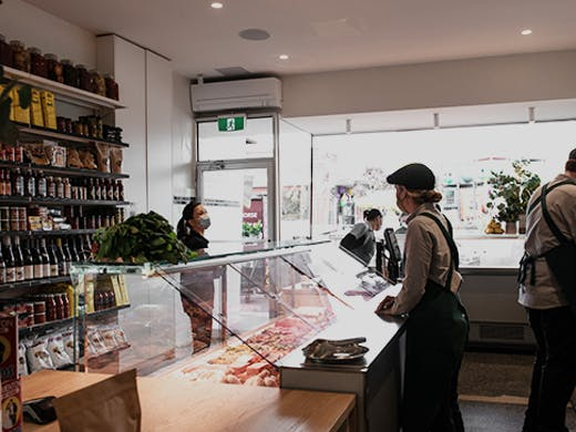 The inside of the butcher with a person being served.