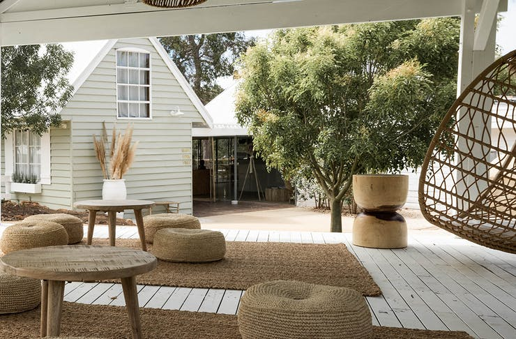 Meelup Farmhouse's deck with cushions and a hanging egg chair