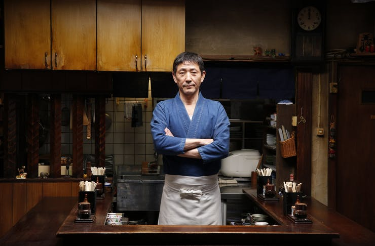 The Master from Midnight Diner posing in his little homely restaurant