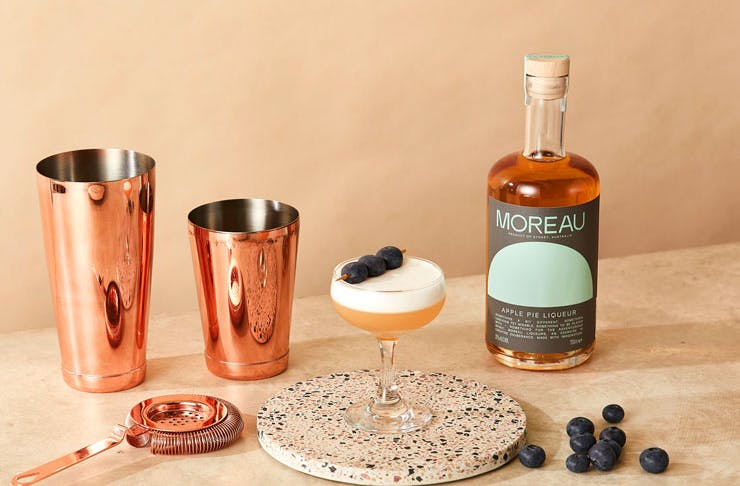 A stylised photo of Moreau Apple Pie liqueur and a cocktail.