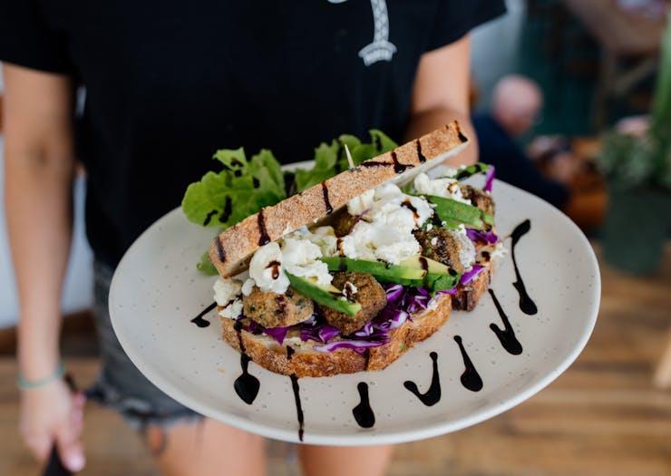 a close up of a smashed avo sandwich