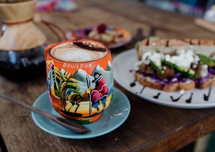 a colourful cup that says 'ecuador'