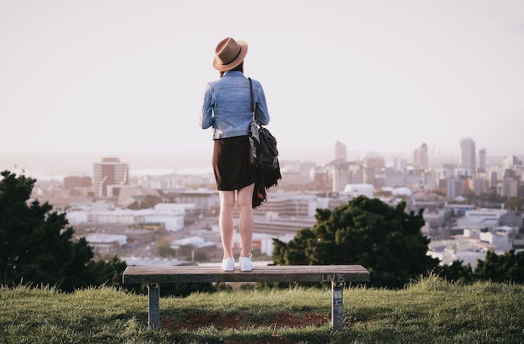 Girl standing on Mount Eden, Places In Auckland That Are Good For The Soul