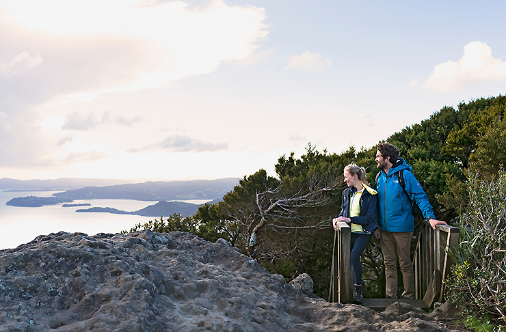 A couple reach the top of Mount Manaia and behold the astounding view.