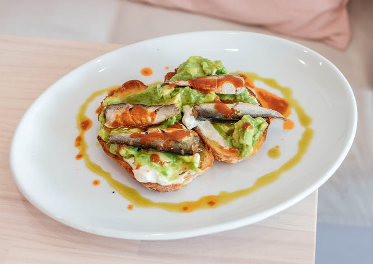 avocado and sardines on soudough toast