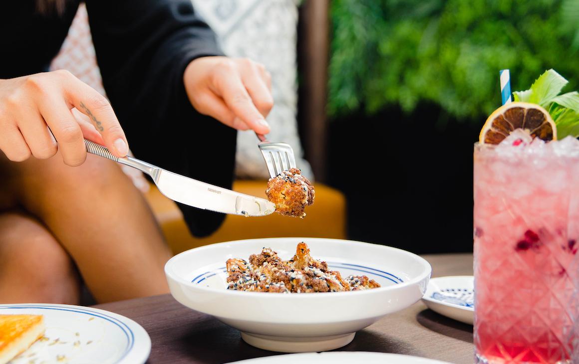 diner enjoys dish from Hadiqa, one of the best Perth CBD restaurants