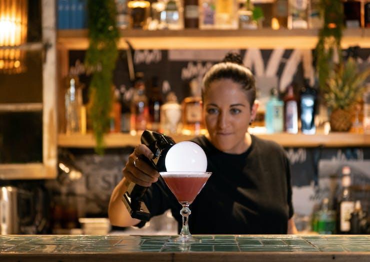 a bartender preparing a bubble cocktail