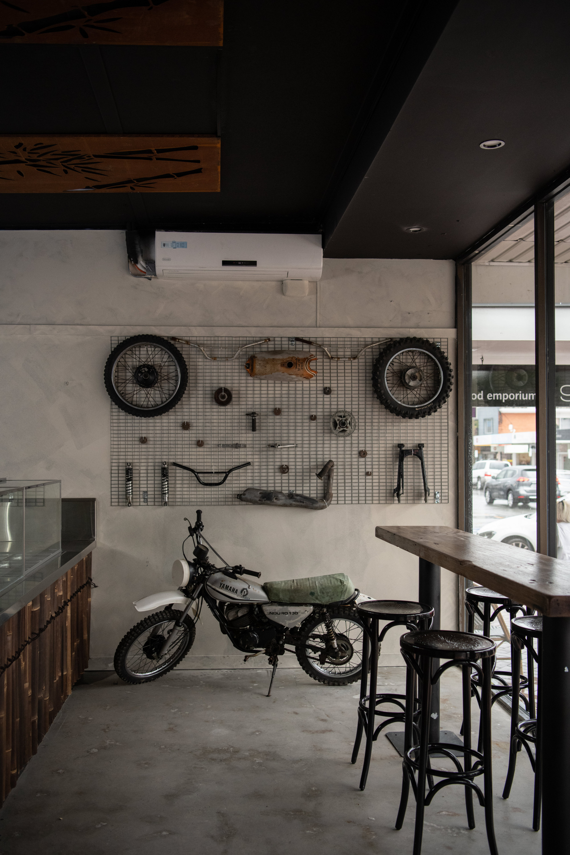 the interior of a banh mi shop with a motorcycle in it