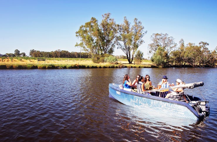 5 friends sit in one of Nauti Picnic's boat on the Swan River