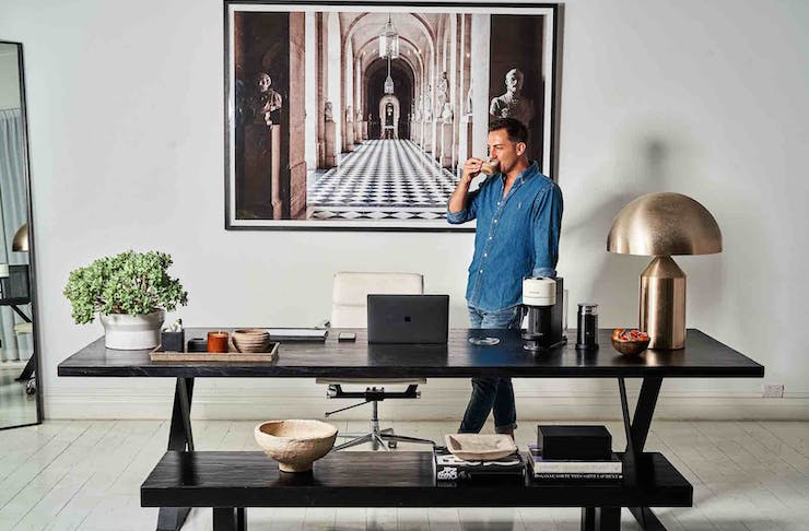 Stylist Steve Cordony stands in his stunning home office.