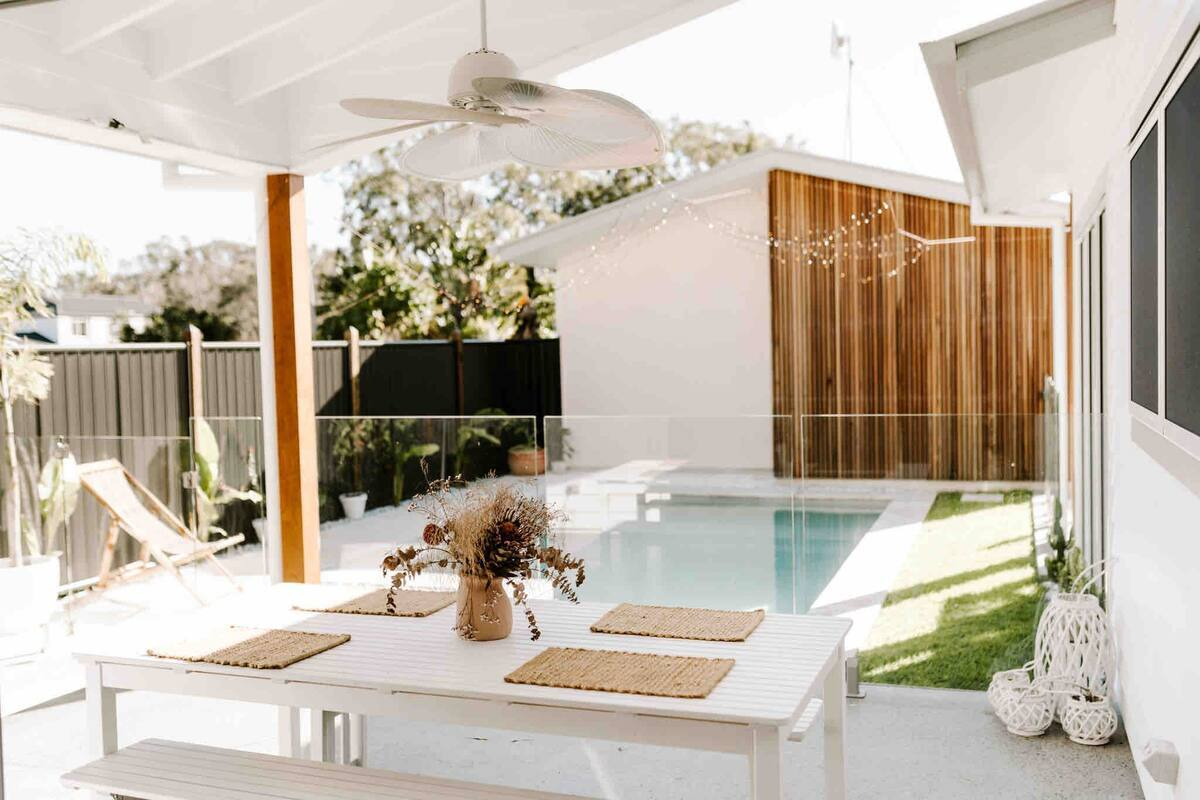a white patio with a pool