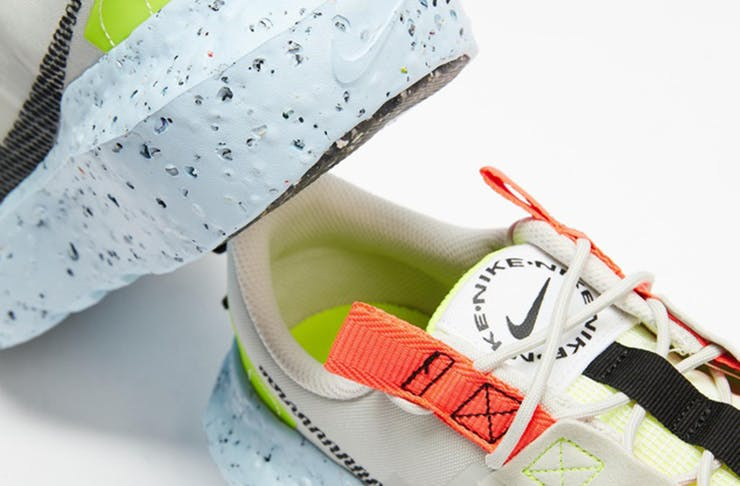 A pair of colourful Nike shoes with a speckled sole.