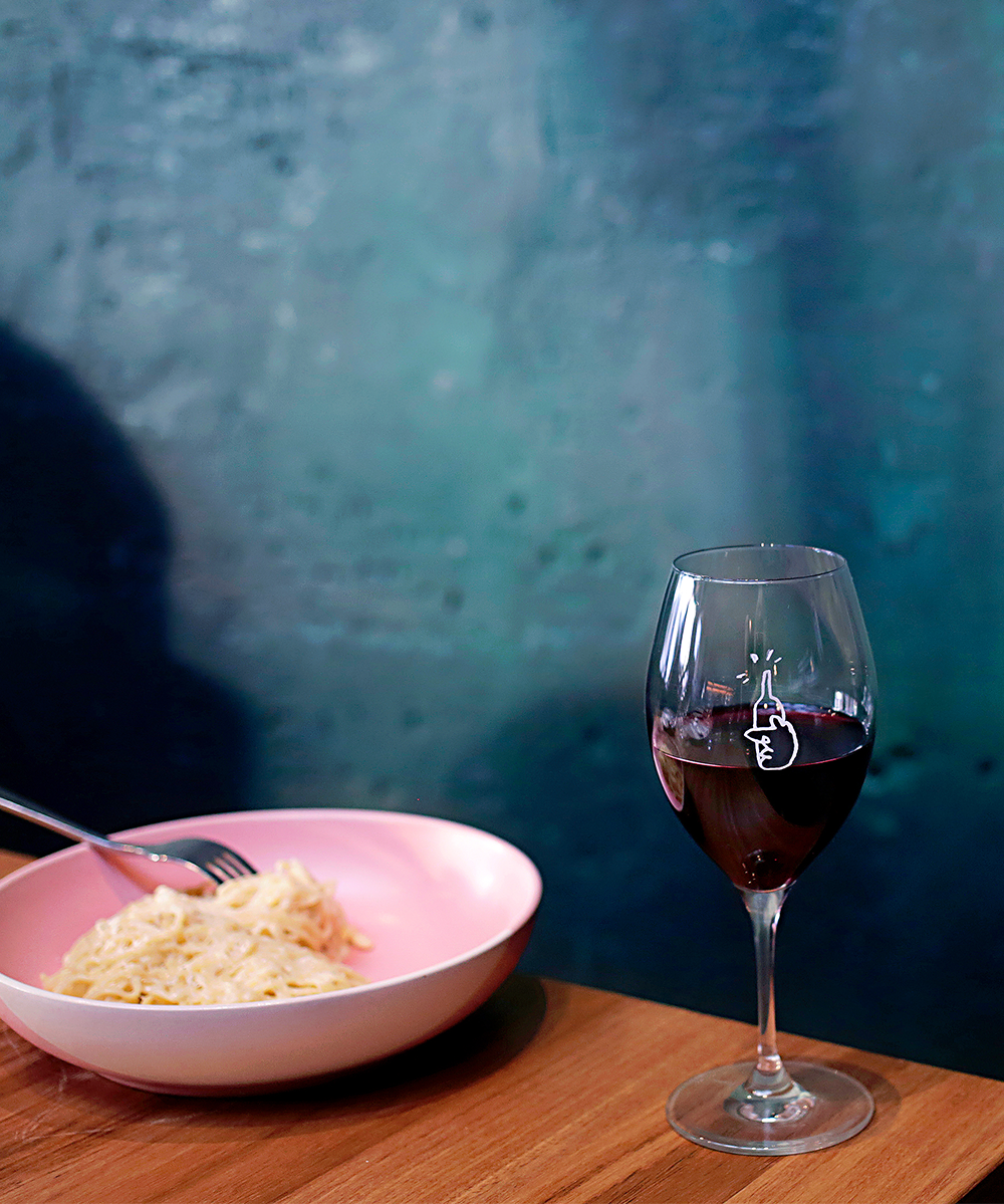 Red wine in a glass and pasta at Northbirdge Wine Room