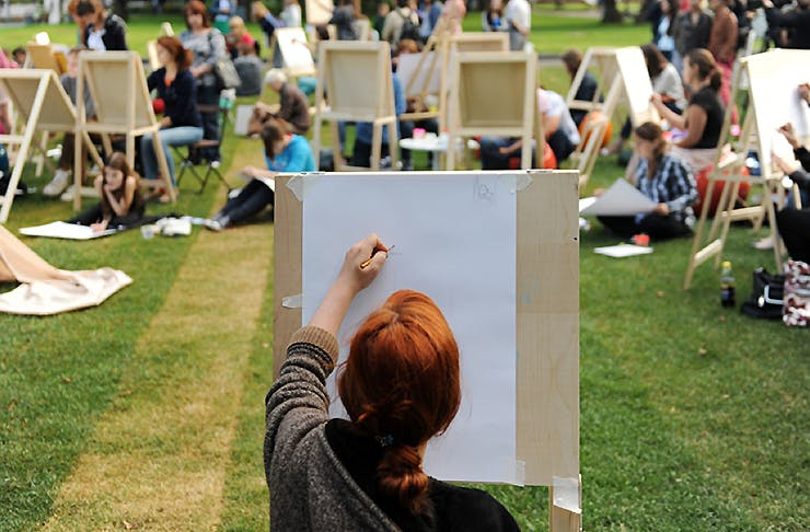 A girl painting in the park