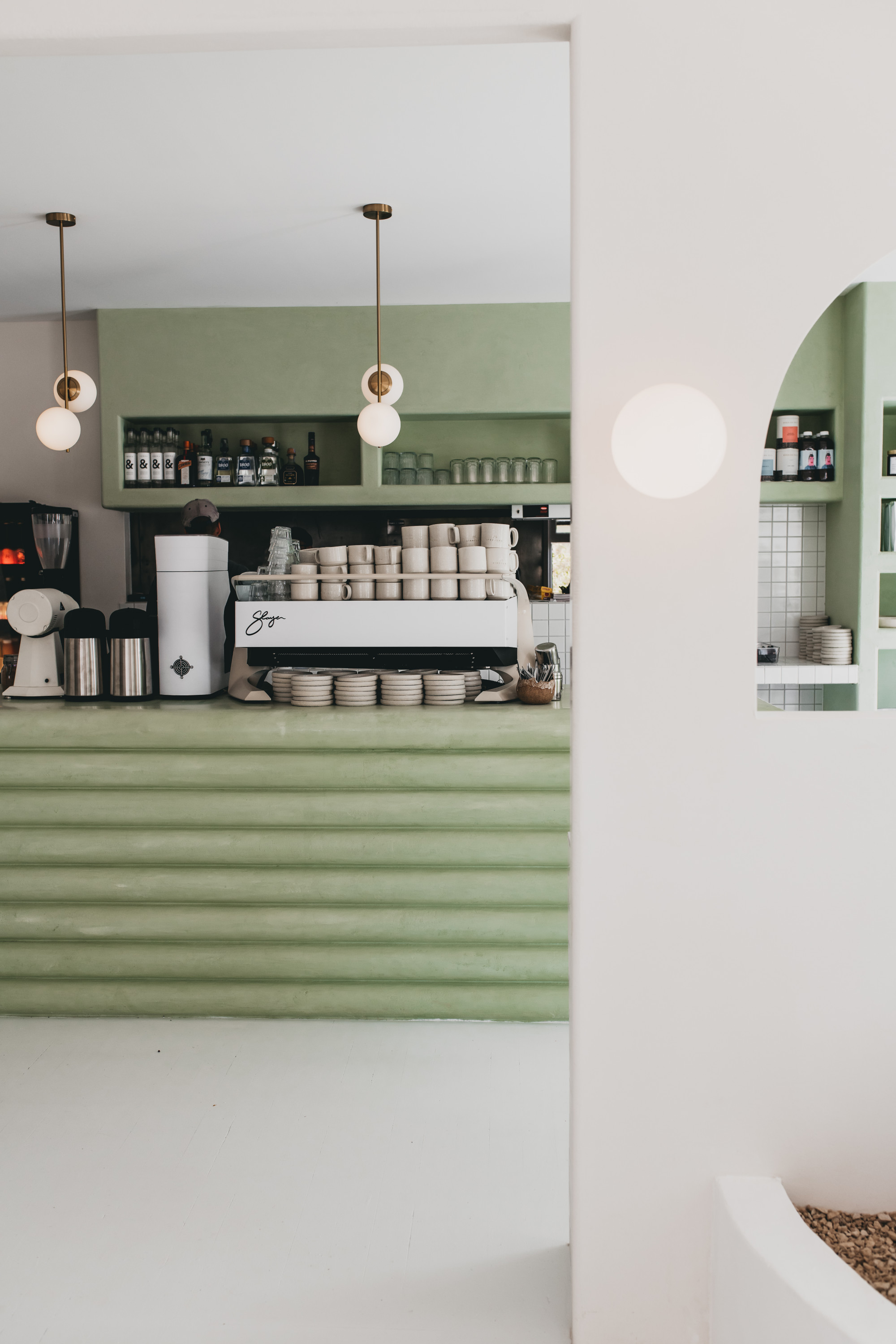 An interior shot of the mint coffee counter at Palm Springs in Burleigh.