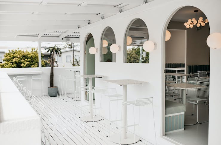 The whitewashed deck and archways of Burleigh's new Palm Springs cafe.