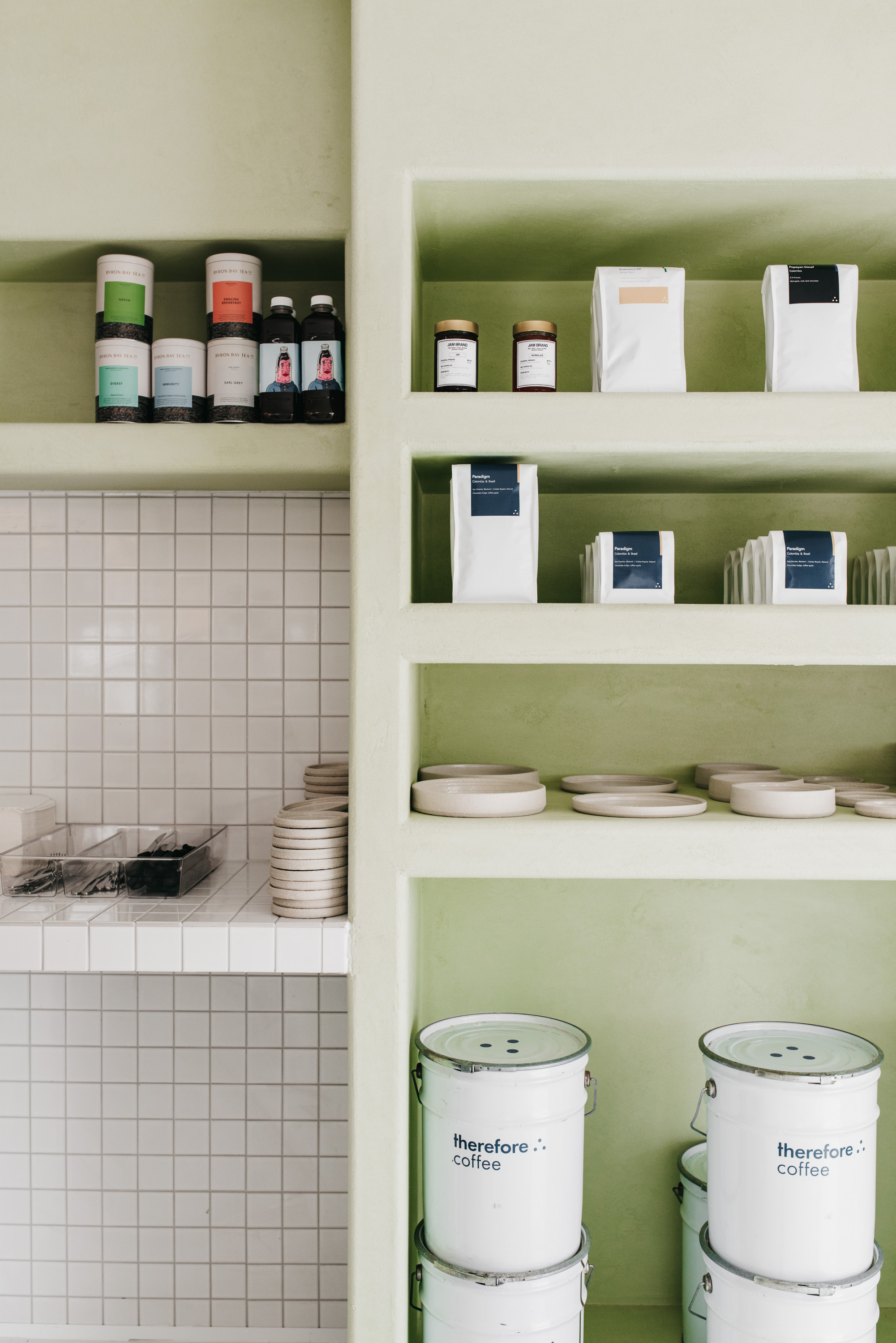 A shot of shelves stacked with various tins and containers.