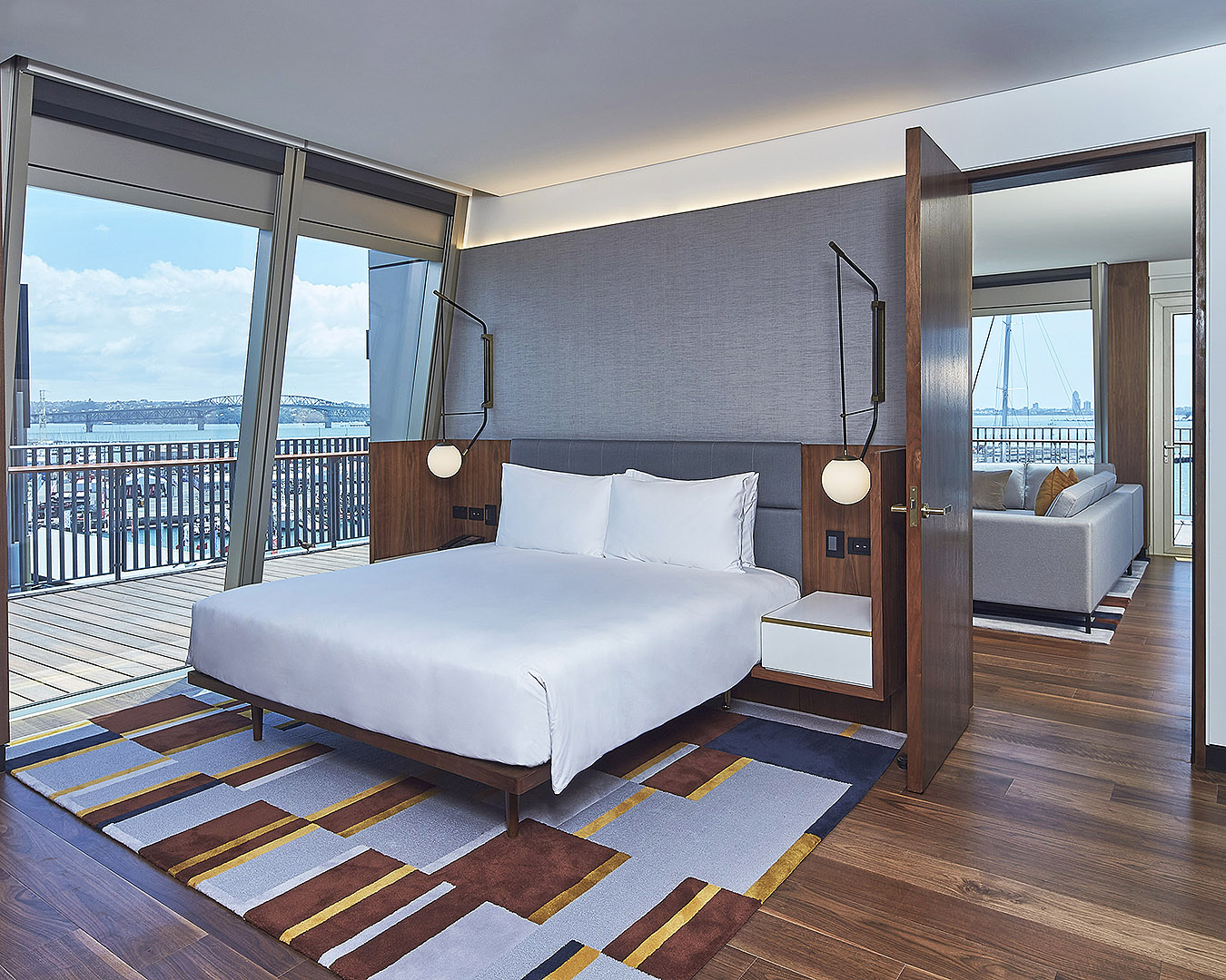 The executive room suite at Park Hyatt shows a bed with amazing views.