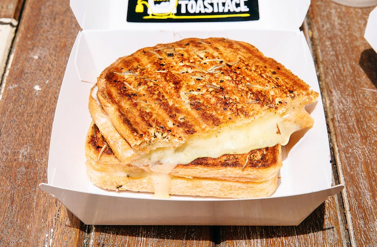 Toastface Grillah's grilled cheese sandwich in a cardboard package