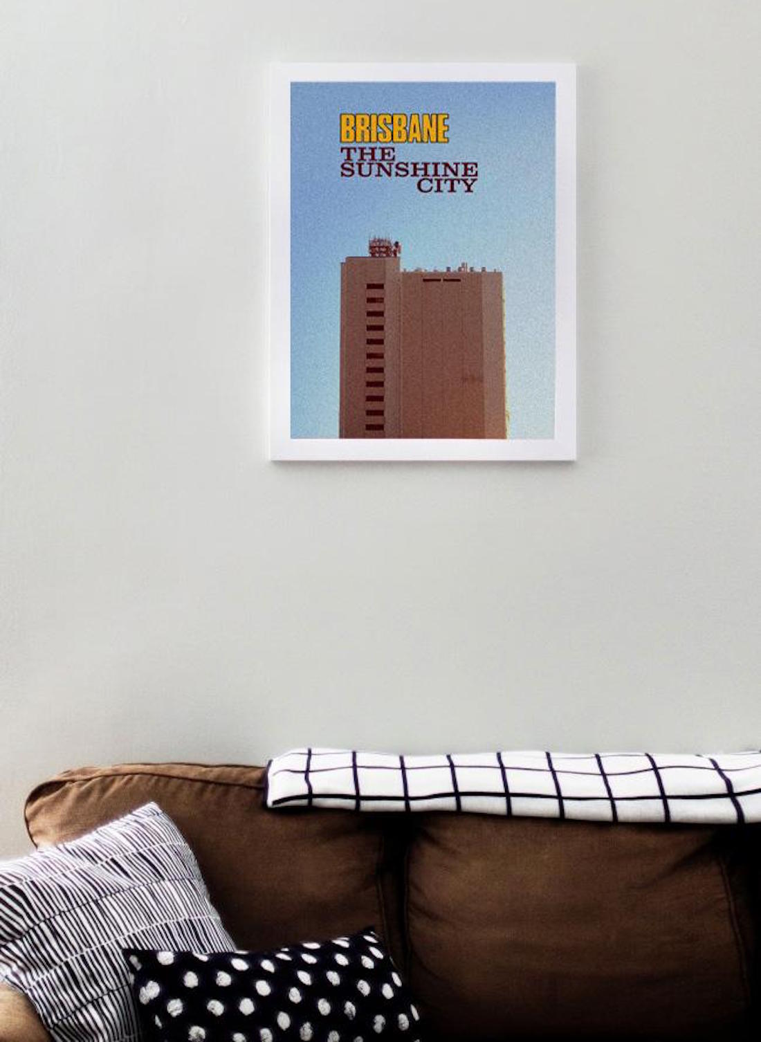 A Brisbane City poster hangs a wall.