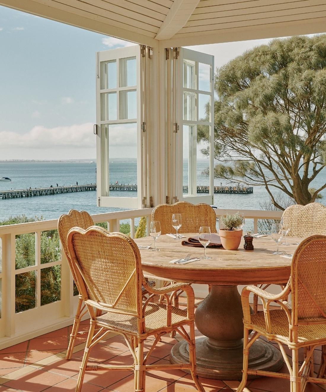 Terrace windows open up to a breathtaking ocean view.