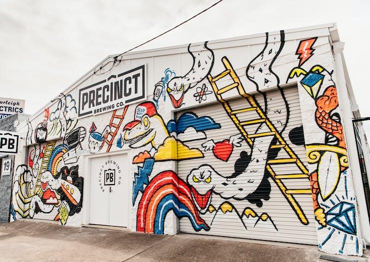 the graffitied exterior of miami's precinct brewing co