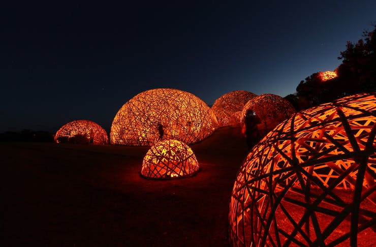A collection of orange-lit domes.
