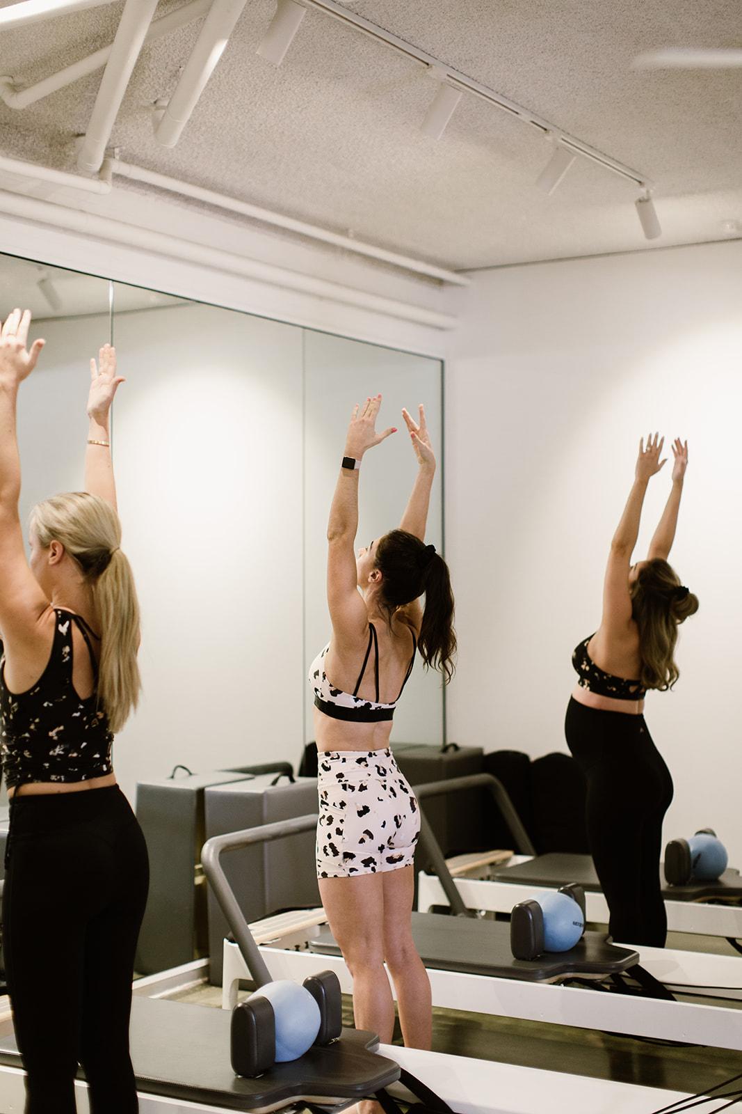 Three people doing yoga wearing Rockwear