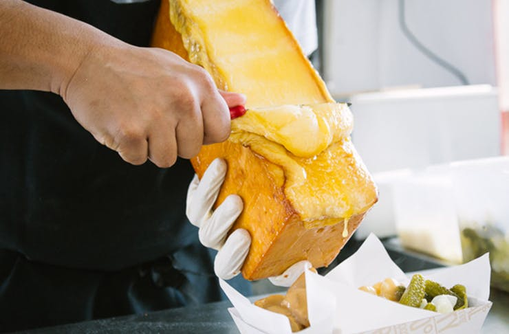 Raclette cheese being served