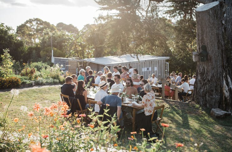 Guests dining at the outdoor urban farm