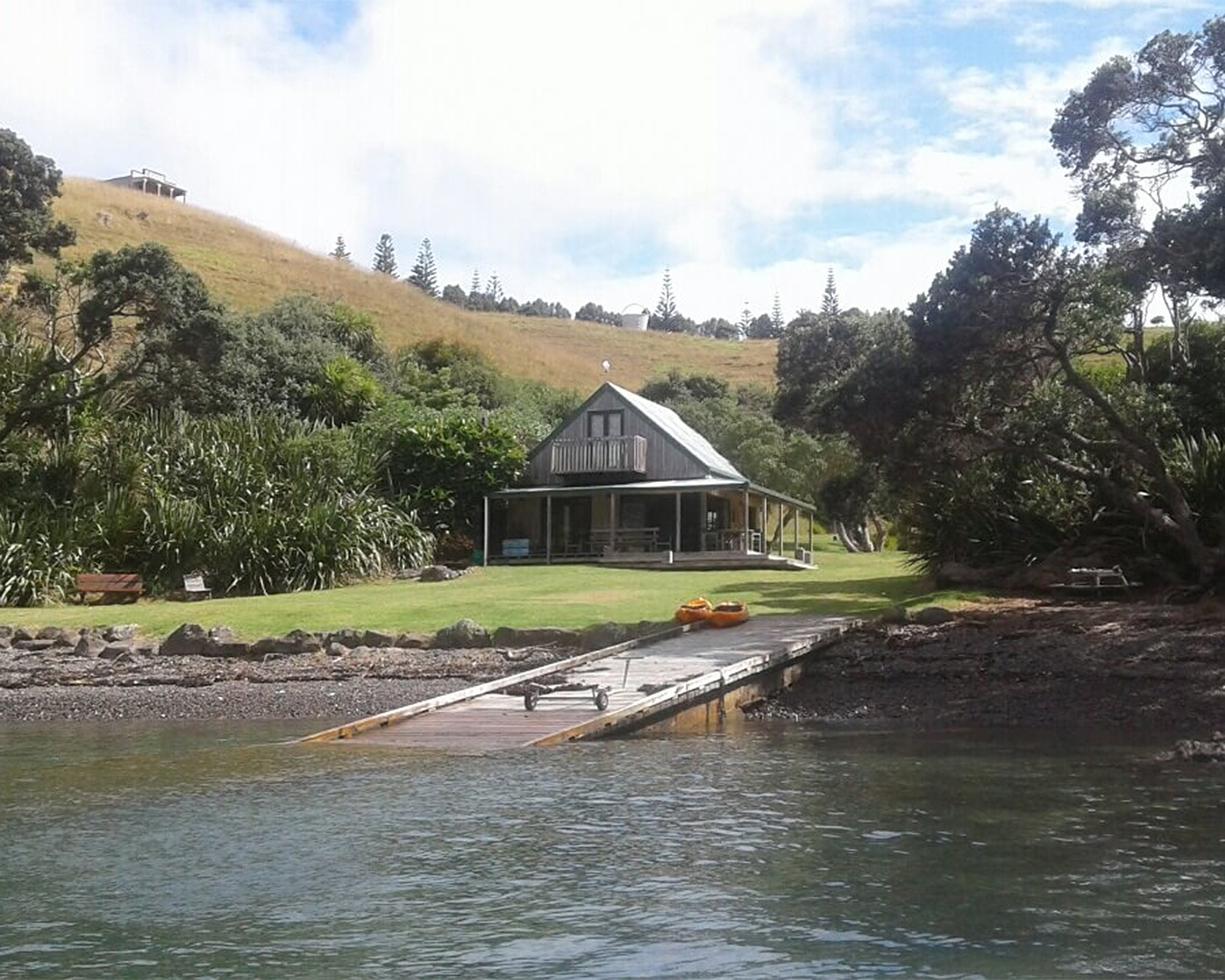 You can hire the whole site at Rocky Cove Bay. A little cabin looks out onto water.