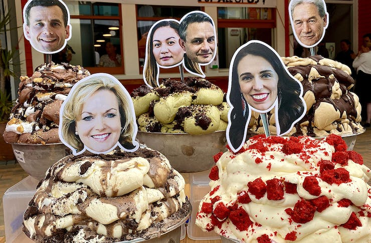 Tubs of delicious looking gelato stacked high with politician's heads on sticks poking out of the top.