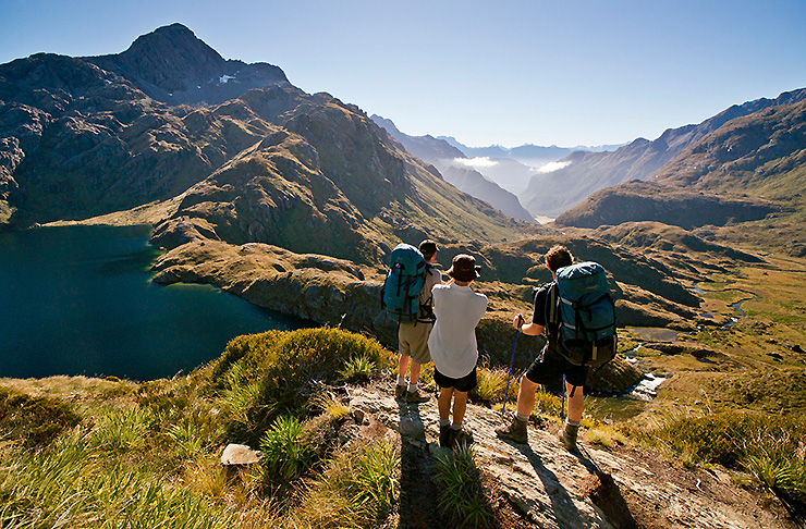 A group stands on the impressive looking Routeburn Track
