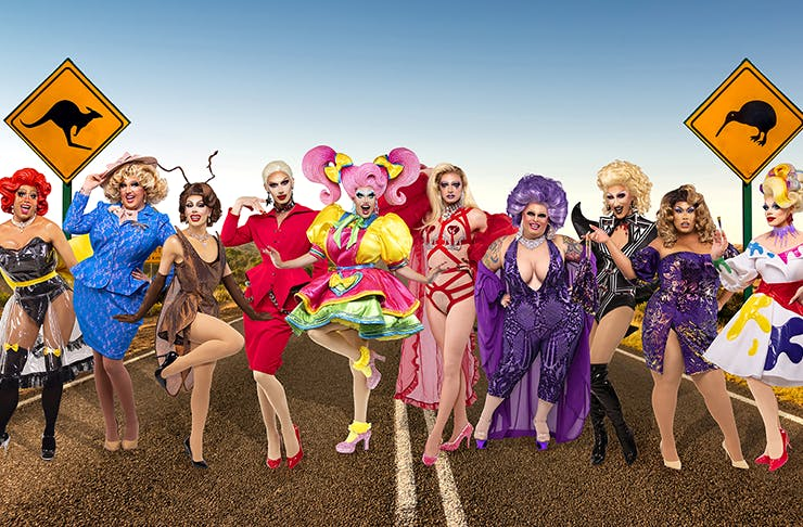 A group of Ru Paul contestants in their outfits on a stretch of Australian outback road.