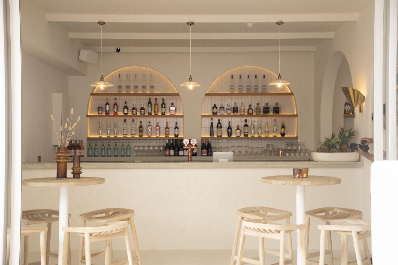 the white interior of a wine bar