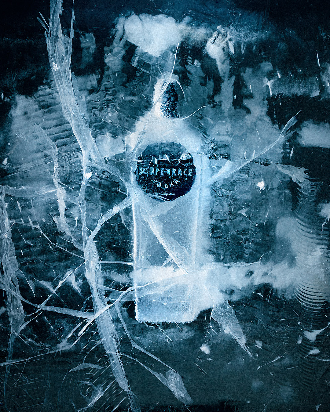 A bottle of Scapegrace vodka dramatically encased in a block of ice.